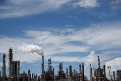 Emissions rising from the smoke stack of an industrial oil and gas refinery. In Corpus Christi, Texas, USA stock photo