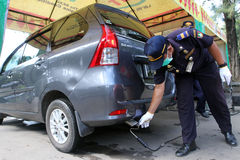 Emissions test. Officers transportation agencies conduct emissions testing on vehicles to reduce air pollution in the city of Solo, Central Java, Indonesia royalty free stock photos