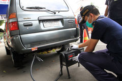 Emissions test. Officers transportation agencies conduct vehicle emissions testing at random in the city of Solo, Central Java, Indonesia Stock Photo