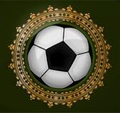 Emlem abstrato com a bola no quadro do ouro Imagens de Stock