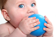 Emma with blue ball. Beautiful baby girl with blue eyes holding a blue ball stock photos