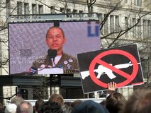 Emma Gonzalez on Screen. Photo of emma gonzalez on a jumbo screen at the march for lives rally in downtown washington dc on 3/24/18.  This person is protesting Royalty Free Stock Photos