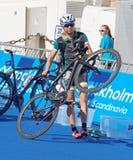 Emma Jackson lifting her bicycle Royalty Free Stock Image