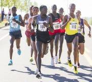 Emmanual Bett from Kenya looks back as he leads the Lilac Bloomsday 2013 12k Run in Spokane WA Stock Photo