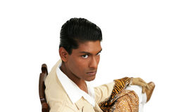 Emmanuel 19. Handsome young exotic man, in cream suit sitting on ark wooden chair Royalty Free Stock Images