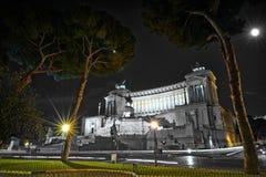 Emmanuel II monument and The Altare della Patria in a summer night near tree in Rome, Italy Stock Photos