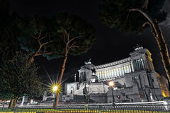 Emmanuel II monument and The Altare della Patria in a summer night near tree in Rome, Italy Stock Photo