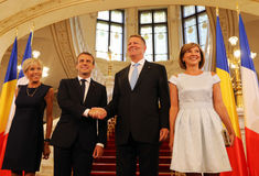 EMMANUEL MACRON AND KLAUS IOHANNIS. France President Emmanuel Macron, center left, and his wife, Brigitte Macron, left, at official photo with Romanian President Stock Image