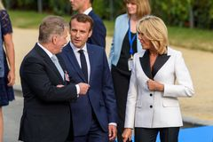 Emmanuel Macron, president of France C and Brigitte Macron R first lady of France Royalty Free Stock Photography