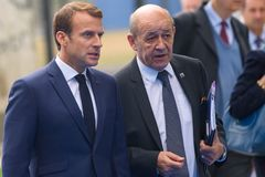Emmanuel Macron, President of France and Jean-Yves Le Drian Minister for Europe and Foreign Affairs arrives to NATO SUMMIT 2018. 12.07.2018. BRUSSELS, BELGIUM stock photography