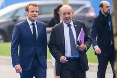 Emmanuel Macron, President of France and Jean-Yves Le Drian Minister for Europe and Foreign Affairs arrives to NATO SUMMIT 2018. 12.07.2018. BRUSSELS, BELGIUM stock image