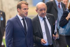 Emmanuel Macron, President of France and Jean-Yves Le Drian Minister for Europe and Foreign Affairs arrives to NATO SUMMIT 2018. 12.07.2018. BRUSSELS, BELGIUM royalty free stock photo