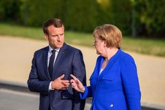 Emmanuel Macron, Voorzitter van Frankrijk en Angela Merkel, Kanselier van Duitsland stock foto