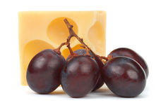 Emmental cheese with grapes Royalty Free Stock Photography
