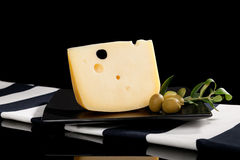 Emmental cheese still life. Royalty Free Stock Images