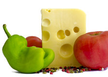 Emmental cheese with tomatoes, pepper Stock Images