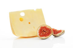 Emmental piece with fig on white. Royalty Free Stock Photos