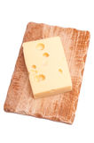 Emmenthaler cheese on wooden board Stock Images