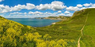 Emmett`s Hill, South West Coast Path, Jurassic Coast, Dorset, UK. South West Coast Path with a view over the Jurassic Coast and the climb up on Emmett`s Hill Stock Photos
