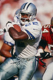 Emmitt Smith Of the Dallas Cowboys in action. Emmitt Smith of the Dallas Cowboys running with power to make big yardage Royalty Free Stock Photography