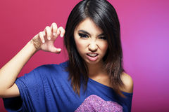 Emoções negativas. A fêmea asiática expressivo ameaça Fotos de Stock Royalty Free