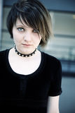 Emo. Young woman on urban background, toned photo f/x, selective focus on eye Royalty Free Stock Photo