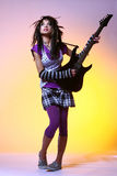 Emo girl and electro guitar. Emo girl with electro guitar royalty free stock photos