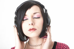 Emo girl in head phones Royalty Free Stock Photography