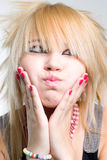 Emo girl portrait. Emo girl blowing cheeks closeup portrait royalty free stock image
