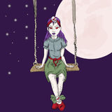 Emo girl sitting on the swing Royalty Free Stock Images