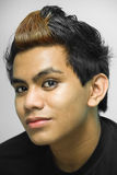 Emo teenager portrait. Closeup portrait of Indian emo or punk teenager with dyed hair stock images
