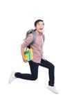 Emocionado feliz de salto del hombre asiático en el fondo blanco Imagen de archivo libre de regalías