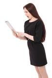 Emociones del adolescente La muchacha sostiene la tableta Fotos de archivo