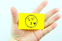 Emoji del dibujo de la mano con la cara del emoticon Imagen de archivo