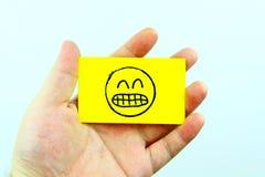 Emoji del dibujo de la mano con la cara del emoticon Foto de archivo