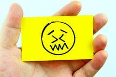 Emoji del dibujo de la mano con la cara del emoticon Fotos de archivo