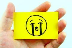 Emoji do desenho da mão com cara do emoticon Fotografia de Stock Royalty Free