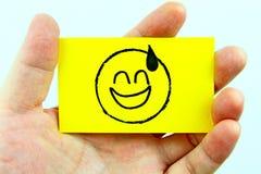 Emoji do desenho da mão com cara do emoticon Fotografia de Stock
