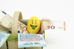 Emoji Easter egg with facial expression I love money placed on euro paper money stock photography