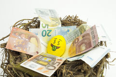 Emoji Easter egg with facial expression. `I love money` placed on euro paper money royalty free stock photo