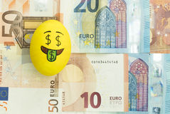 Emoji Easter egg with facial expression. `I love money` placed on euro paper money royalty free stock images