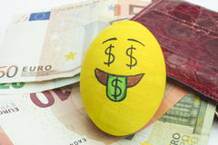 Emoji Easter egg with facial expression. `I love money` placed on euro paper money stock images