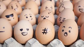 Emoji eggs with selective focus on the hashtag sign surrounded with the emojis. Emoji is expression stickers used in the chat stock photos