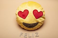 Emoji. Fabric cushion with emoji face in color background royalty free stock photography