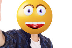 Emoji head man taking selfie. Portrait of an emoji head man taking selfie. Isolated white background stock photo