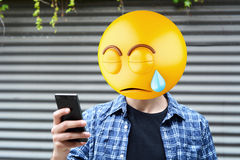 Emoji head man. Using a smartphone. Emoji concept stock photos