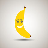 Emoji jaune de banane avec un smiley et un regard doux Photo libre de droits