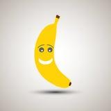 Emoji jaune de banane avec un smiley et un regard doux Photo libre de droits
