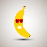 Emoji jaune de banane dans l'amour Émoticône pour des apps Banane jaune franc Photo libre de droits