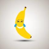 Emoji jaune de banane riant dur avec des larmes Photo stock